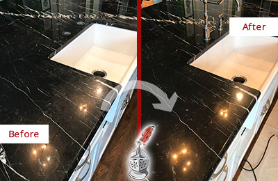 Before and After Picture of Black Marble Countertop Sealed to Reverse Water Damage